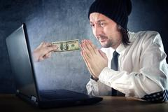 Online money funds, businessman asking for money - stock photo