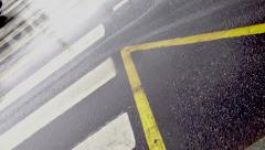Wet road. Cars drive through the crosswalk. Stock Footage