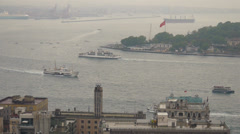 Ships and boats run through Bosphorus channel along streets of Istanbul Turkey Stock Footage