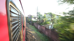 View of Colombo suburbs from passing train. Stock Footage