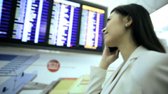 Stock Video Footage of City Airport Departure Board Asian Chinese Business Finance Woman