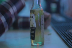 Drunk POV at night club bar, bottle on counter tripling, click for HD - stock footage
