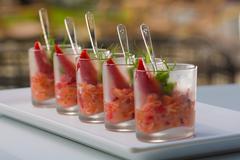 fresh salad with shrimps, salmon, avocado and strawberries - stock photo