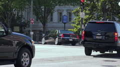 Motorcade turns in near White House, Washingotn, DC Stock Footage