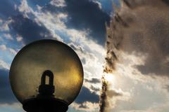 sand projection in the air and city lamp silhouette - stock photo