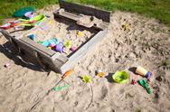 Stock Photo of childhood. sandpit sandbox with toys on playground.