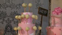Pink cake pop biscuits vertical pan view 02 Stock Footage