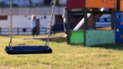 Empty swing swinging in the park Stock Footage