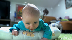 Stock Video Footage of Little child looking to the camera with curiosity