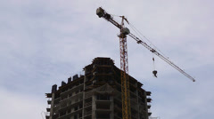 Working elevating crane on a construction site. Time lapse. Stock Footage