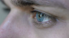 Cute young man opening his beautiful blue eyes: attractive serious gaze; 4k Stock Footage