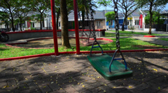 Empty swings swaying Stock Footage