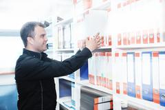 male adult in archive library - stock photo