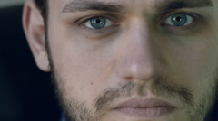 attractive young man with serious gaze looking into the camera: 4k footage - stock footage