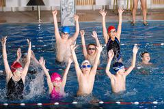 .childrens having fun in a swimming pool Stock Photos