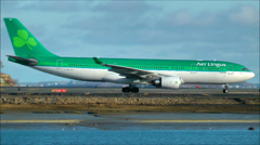 Aer Lingus plane taxies along waters edge Stock Footage