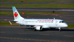 Air Canada plane taxies runway - stock footage