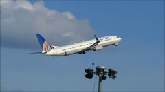 United Airlines plane climbs after takeoff Stock Footage