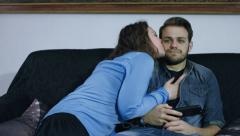 Indifferent man with cute girl trying to seduce him on the sofa, 4k Stock Footage