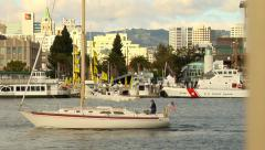 BOAT PASSING BY OAKLAND Stock Footage