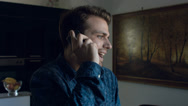 Stock Video Footage of young man having angry call at the mobile phone: smartphone, interior, home