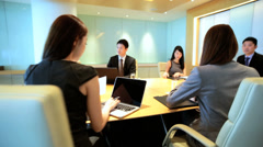 Male Female Asian Chinese Business Teamwork Boardroom Meeting Laptop - stock footage