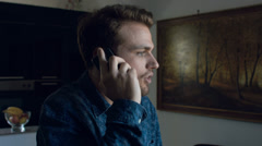Disbeliever man having  call at the mobile phone: interior, portrait Stock Footage