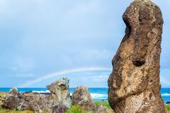 Moai and rainbow Stock Photos
