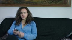 Couple watching tv on the sofa have problem with remote control Stock Footage