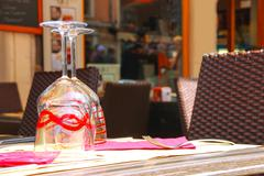 table in the cafe serving famous venetian murano glasses - stock photo