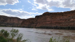 clouds moving over colorado river moab utah - stock footage