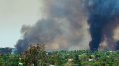 Two Smoke Columns From a Large Wild Fire. 4k - stock footage