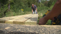 Walking trails closeup timbers secured for connector bridge Stock Footage