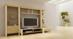 lounge room interior with bookshelf and TV - stock photo