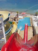 red water slide fun - stock photo