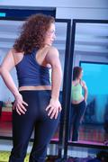 girl with attractive buttom in fitness studio - stock photo