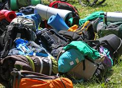 pile of knapsacks of scouts during an excursion in the nature park - stock photo