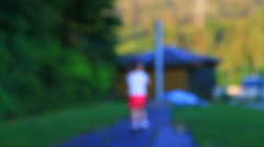 Little girl all alone in the park Stock Footage