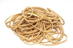 Isolated collection of elastic bands stacked in a heap Stock Photos