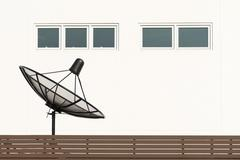 Satellite dish tv antennas beside house Kuvituskuvat