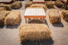 table and straw chair. - stock photo
