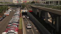 Traffic entering an underpass of the Huangpu River in  Shanghai Pudong Stock Footage