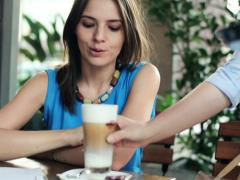 Young woman gets delicious coffee from waiter in cafe NTSC Stock Footage