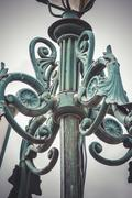 retro, traditional street lamp with decorative metal flourishes - stock photo