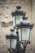 europe, traditional street lamp with decorative metal flourishes - stock photo
