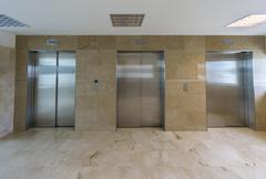 Modern elevators with closed doors Kuvituskuvat