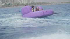 Group of friends enjoying tubing attraction on the water 10 Stock Footage