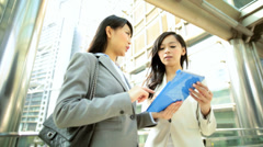Asian Chinese Females Outdoors Business Wireless Tablet Hotspot Planning - stock footage
