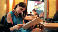 Stock Video Footage of Young woman reading menu in restaurant HD