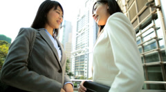 Ethnic Asian Chinese Businesswomen Meeting City Downtown - stock footage